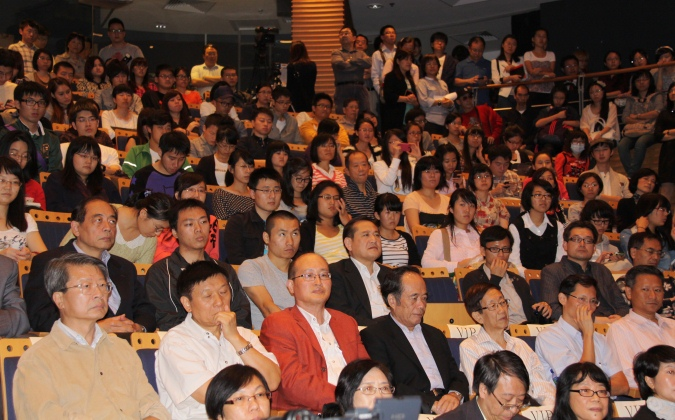 The event attracts a full-house audience, and even the corridor is packed