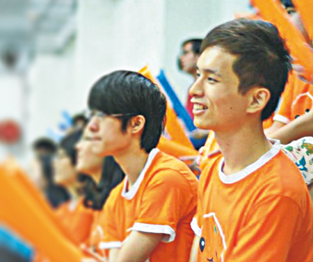 Wu Zhongtian cheers for his fellow students at an inter-college sports meet (picture courtesy of Bill Chen)
