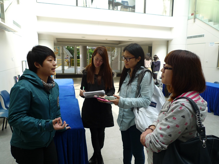 Tracy Choi (left), director of I'm Here, gives an interview to our UM Reporters