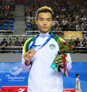 Chong Wai Lon wins a bronze medal in karate at the East Asian Games (photo courtesy of Sports Weekly)