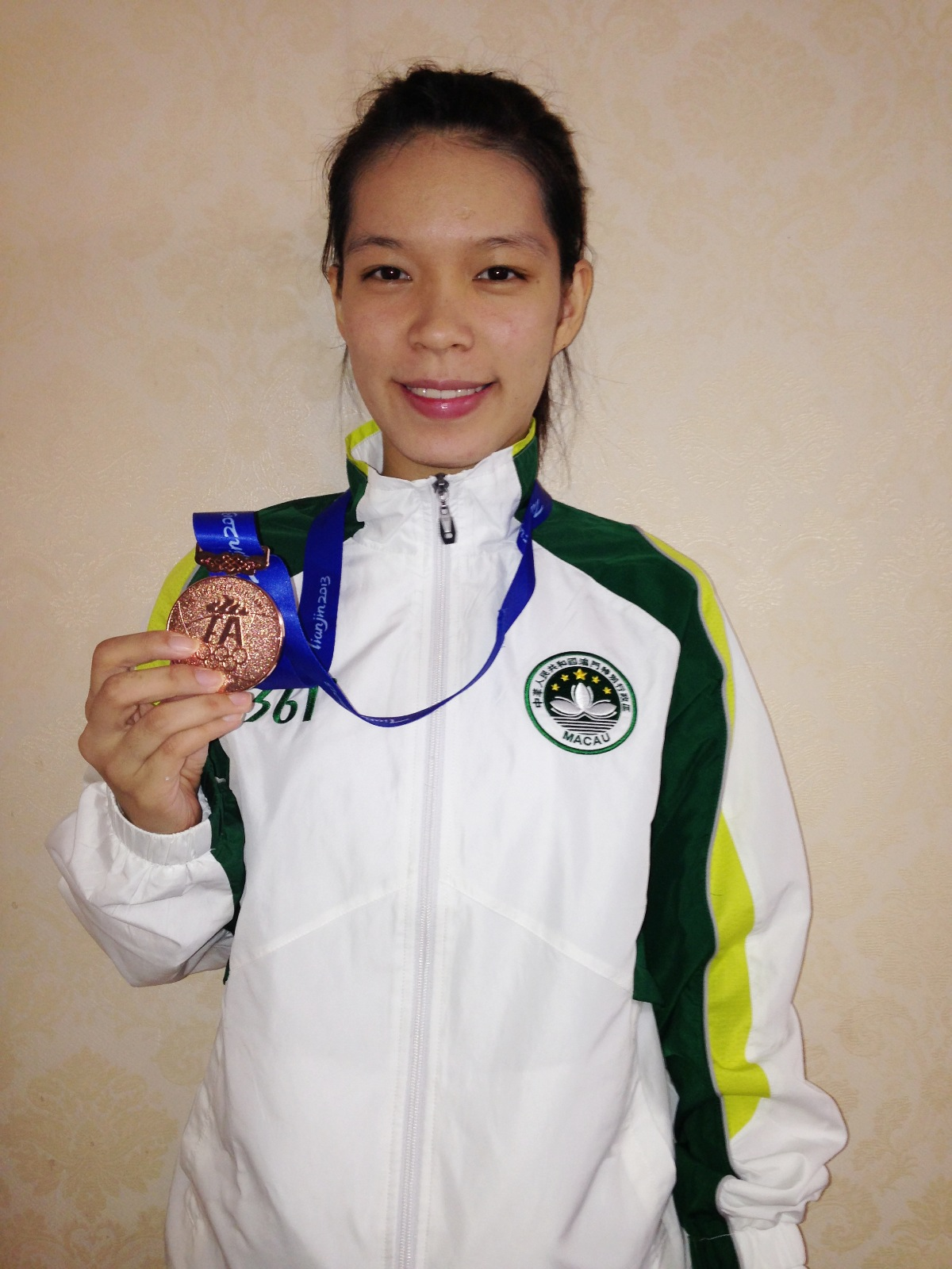 Wong Sok I wins a bronze medal in karate at the East Asian Games