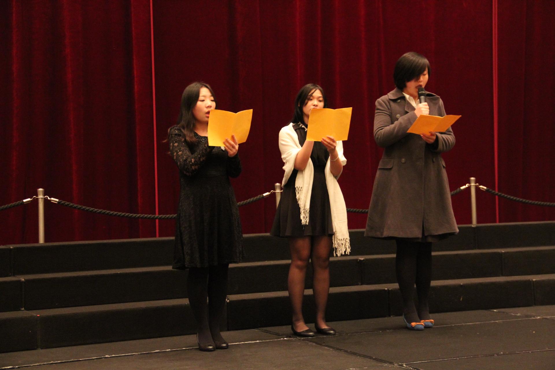 East Asia College members Ms. Wang Yawei, Ms. Chan Choi Ieng and Ms. Shen Qiaochu sing Christmas carols