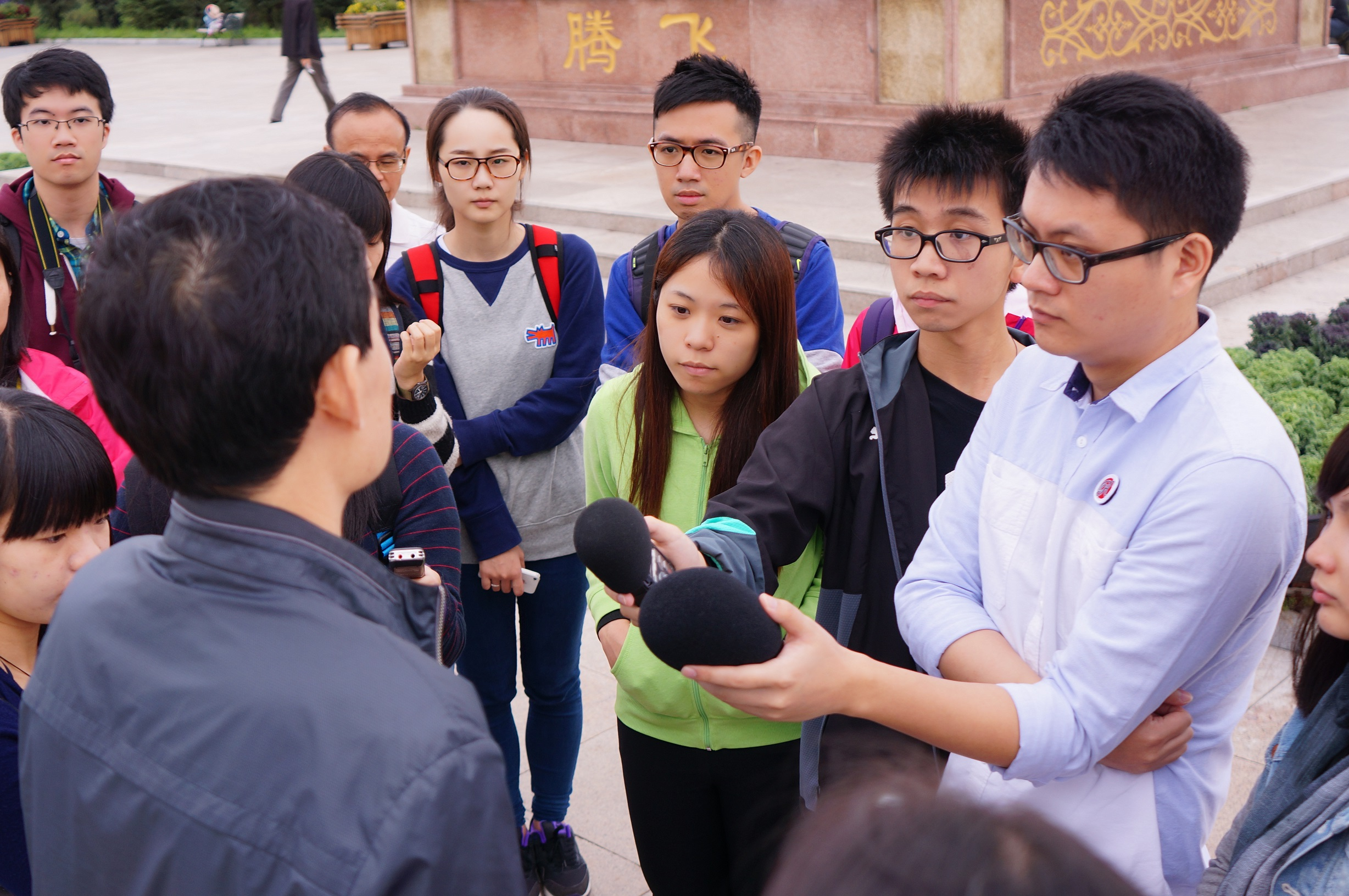 (From right) UM Reporters Clarence and Rogerinterview a representative of China National Radio