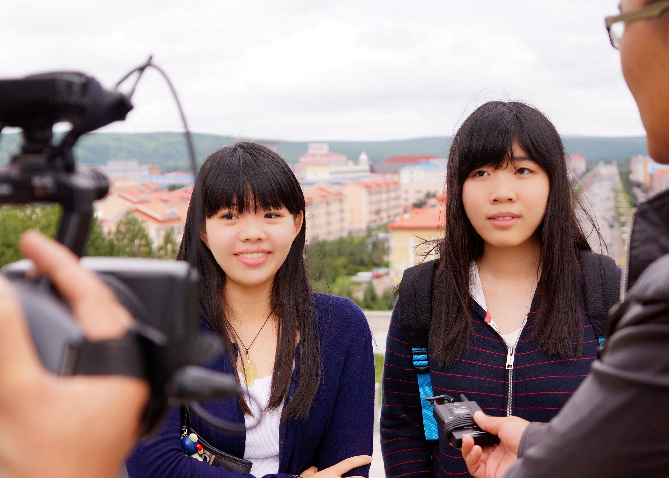 (From left) UM Reporters Momo and Terri are interviewed by a local media company