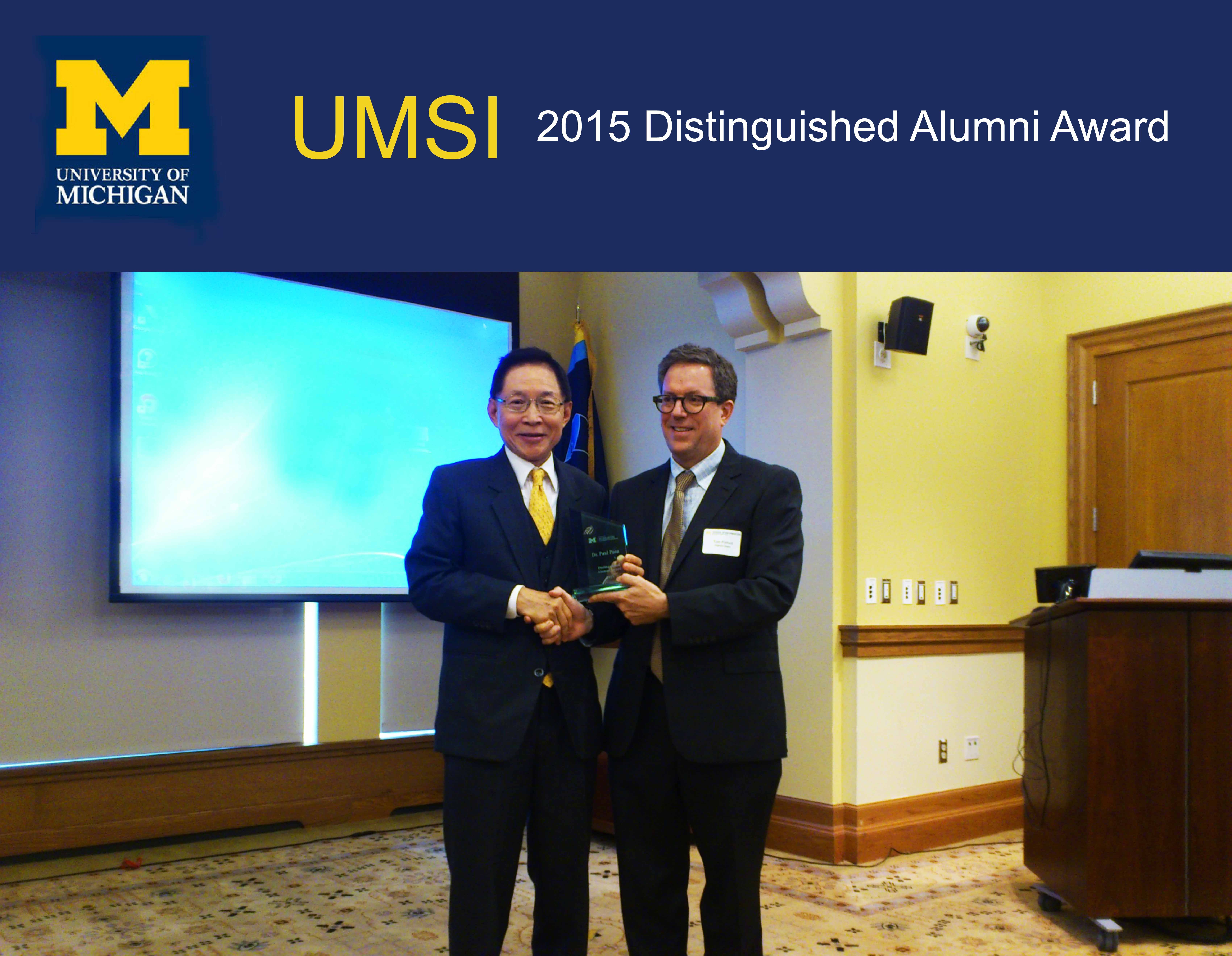 UM Librarian Dr Paul Poon (left) receives the Distinguished Alumni Award from the University of Michigan