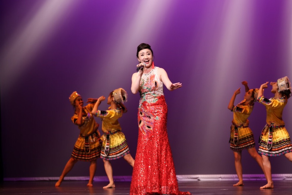 A UM PhD student performs at the Third Chinese Culture and Arts Festival in Cannes, France