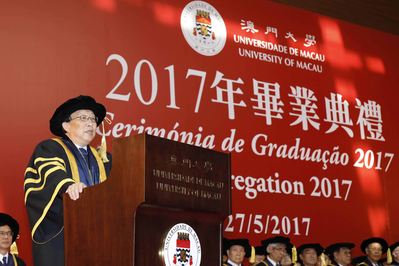 Wei Zhao congratulates the graduates