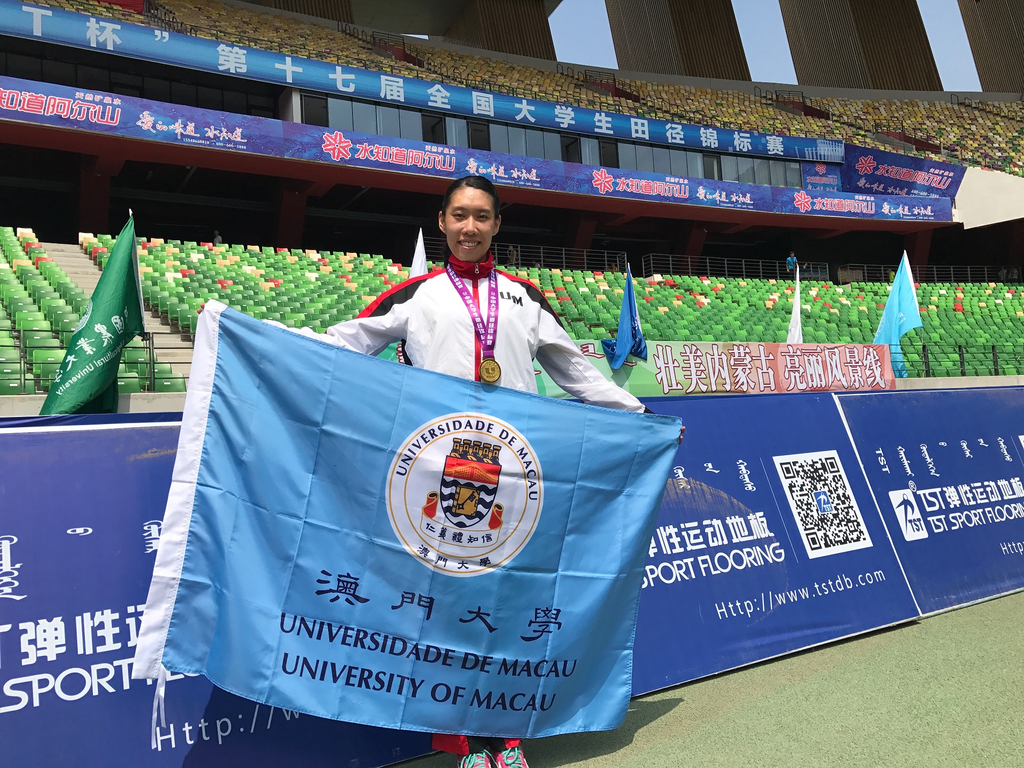 Ng Weng Ian wins the gold medal in the Women's 400-Metre Group B category