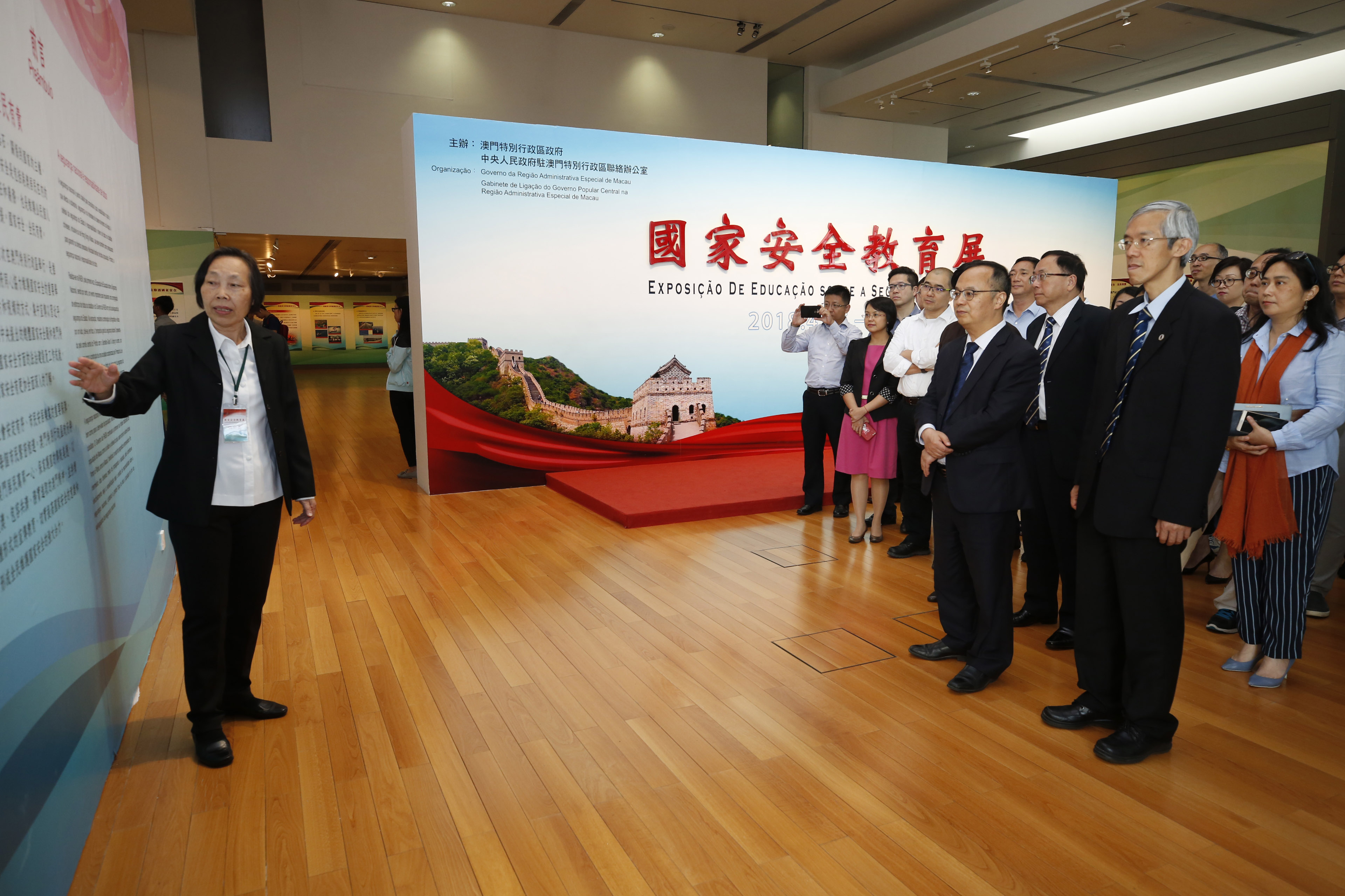 Rector Yonghua Song and the university's senior management team in the exhibition