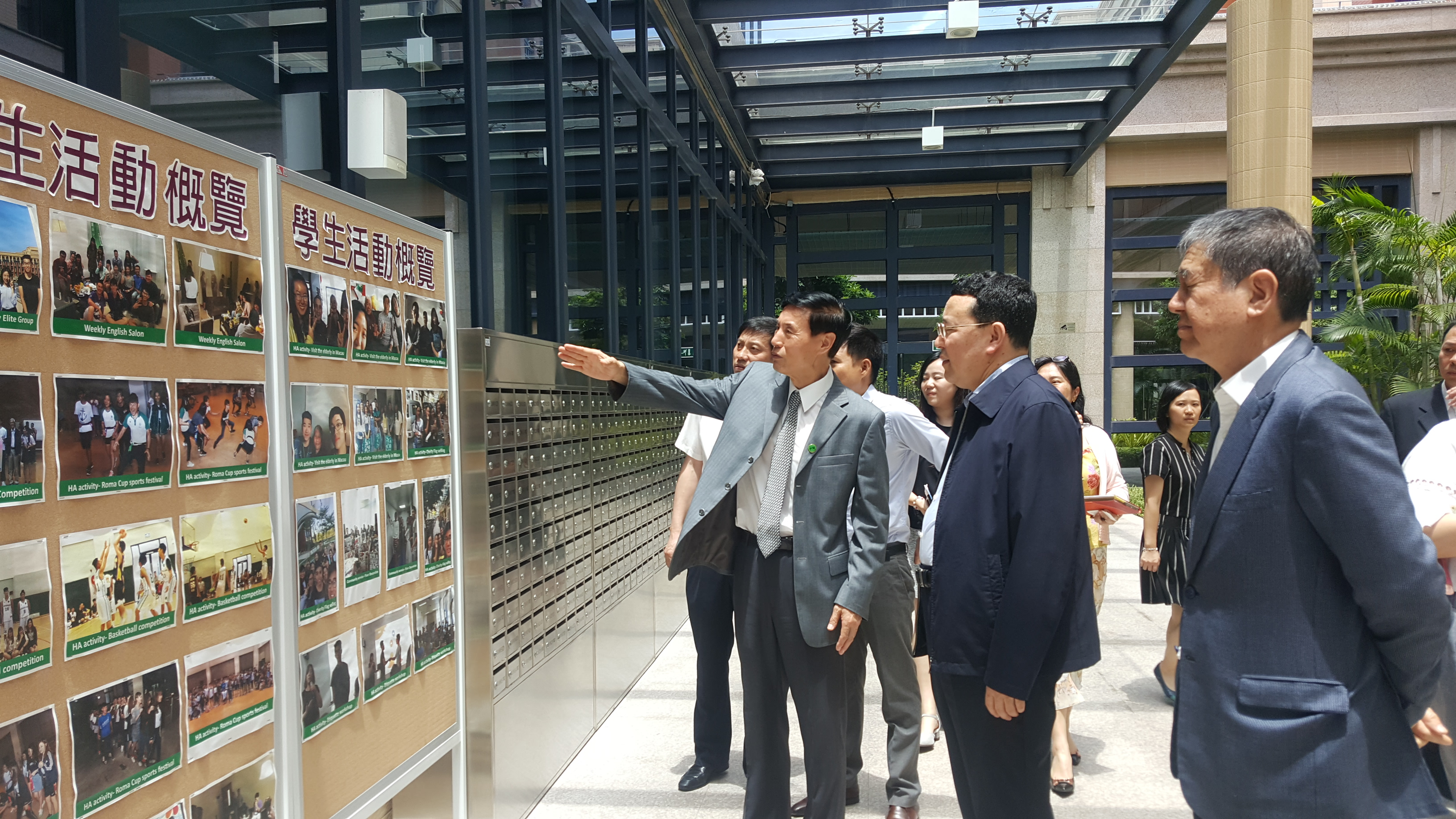 Xu shows the guests around Ma Man Kei and Lo Pak Sam College