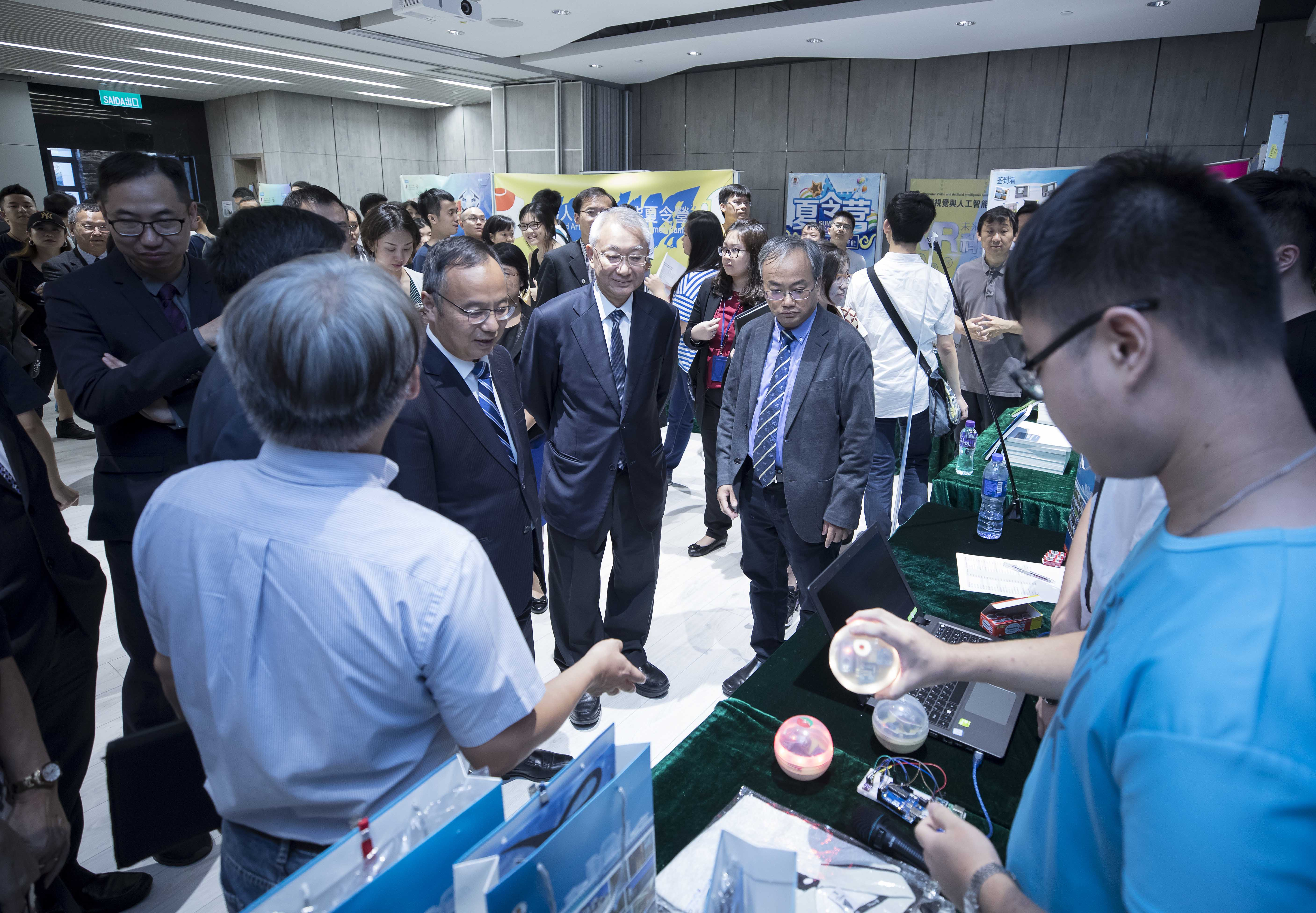 Guests visit the booths at a science promotion summer camp, which is part of the STEM Programme