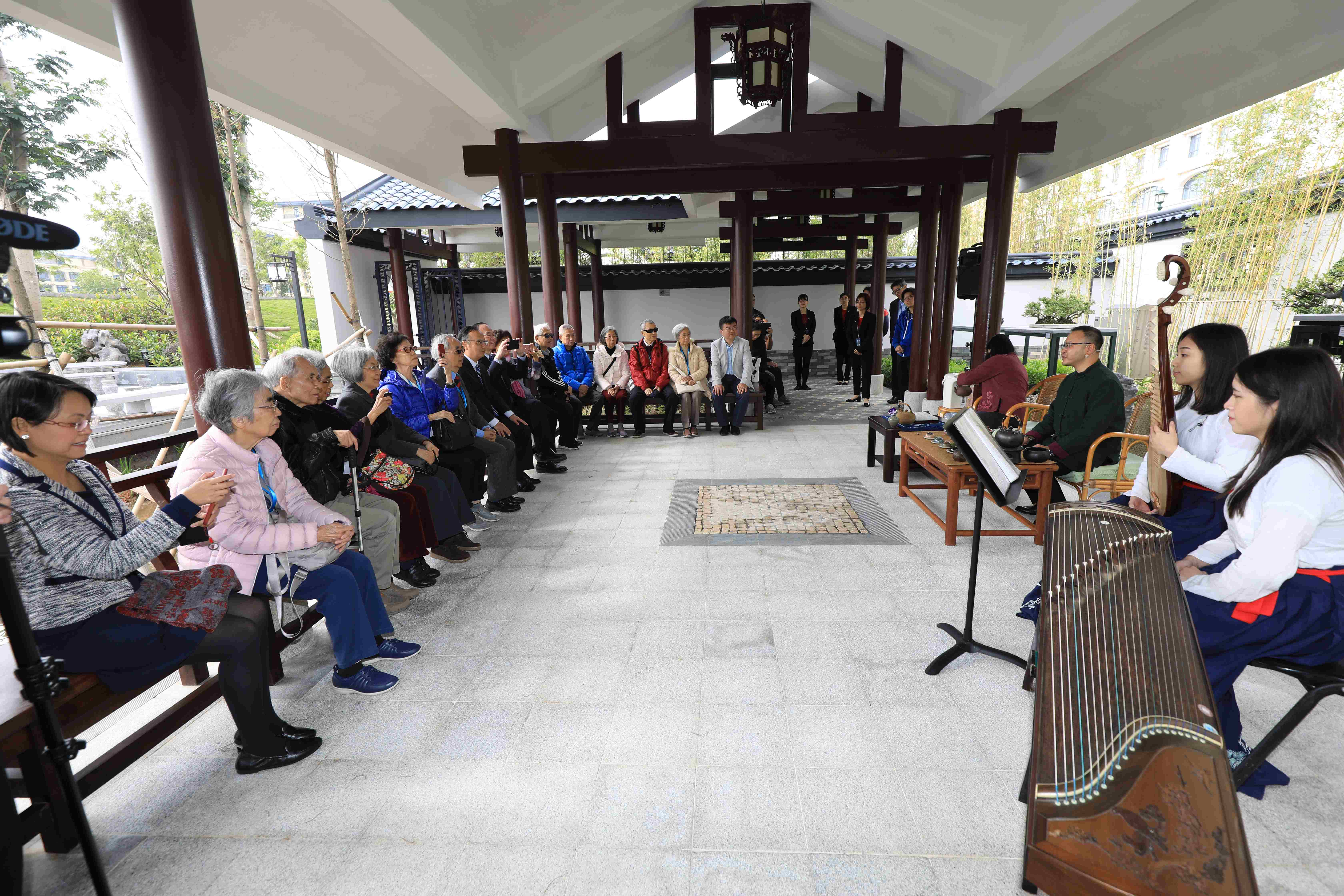 Guests enjoy a Chinese tea ceremony and music performance