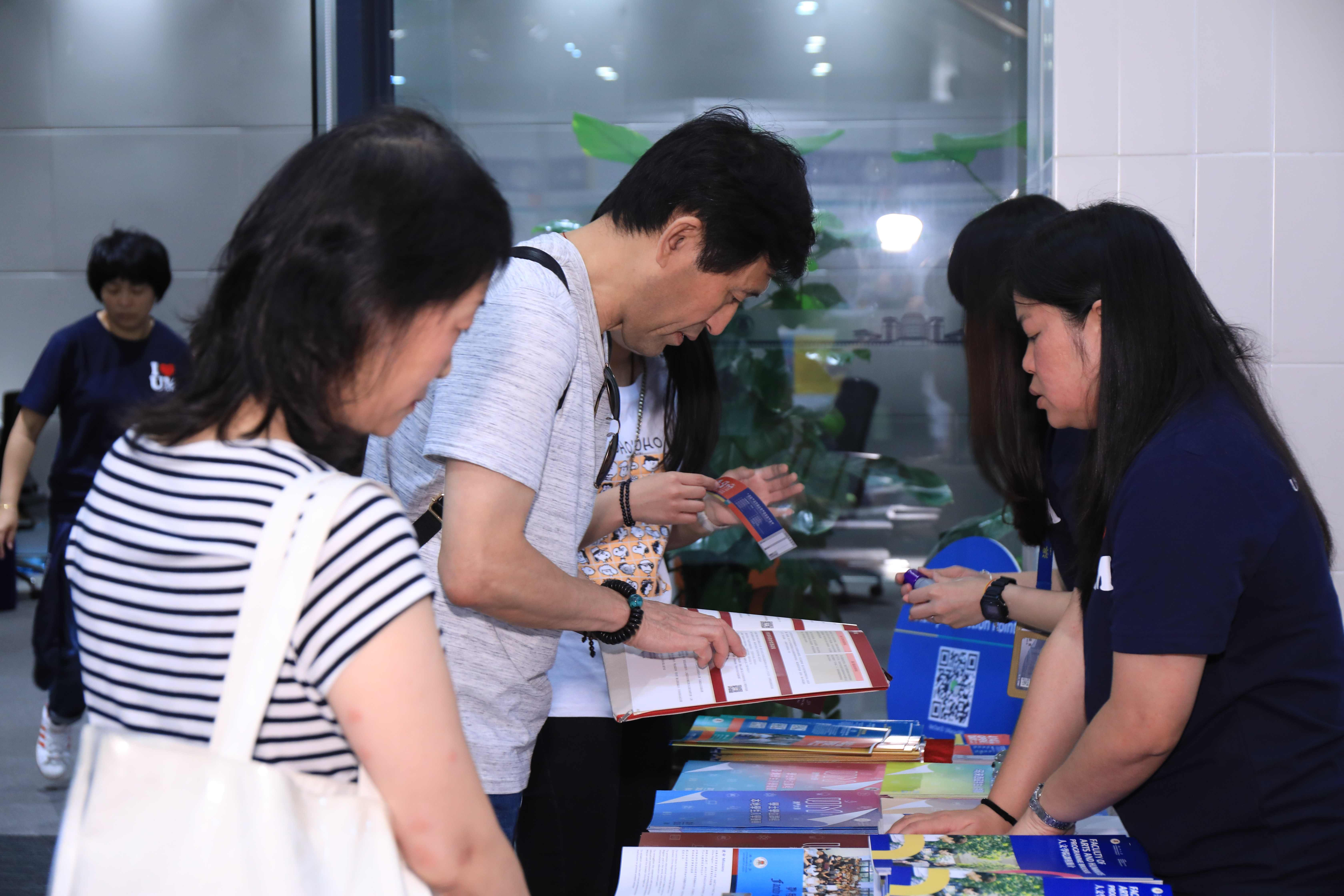 Many parents attend the Open Day with their children to obtain admission information