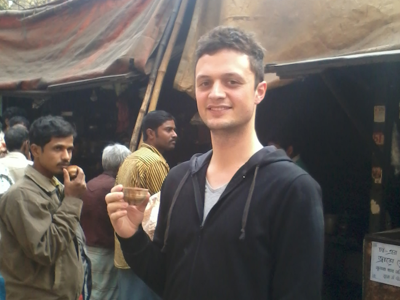 Prof Ehrlich in Kolkata, India, in 2013, holding Chai, a local tea made from milk and spices, in a clay cup.