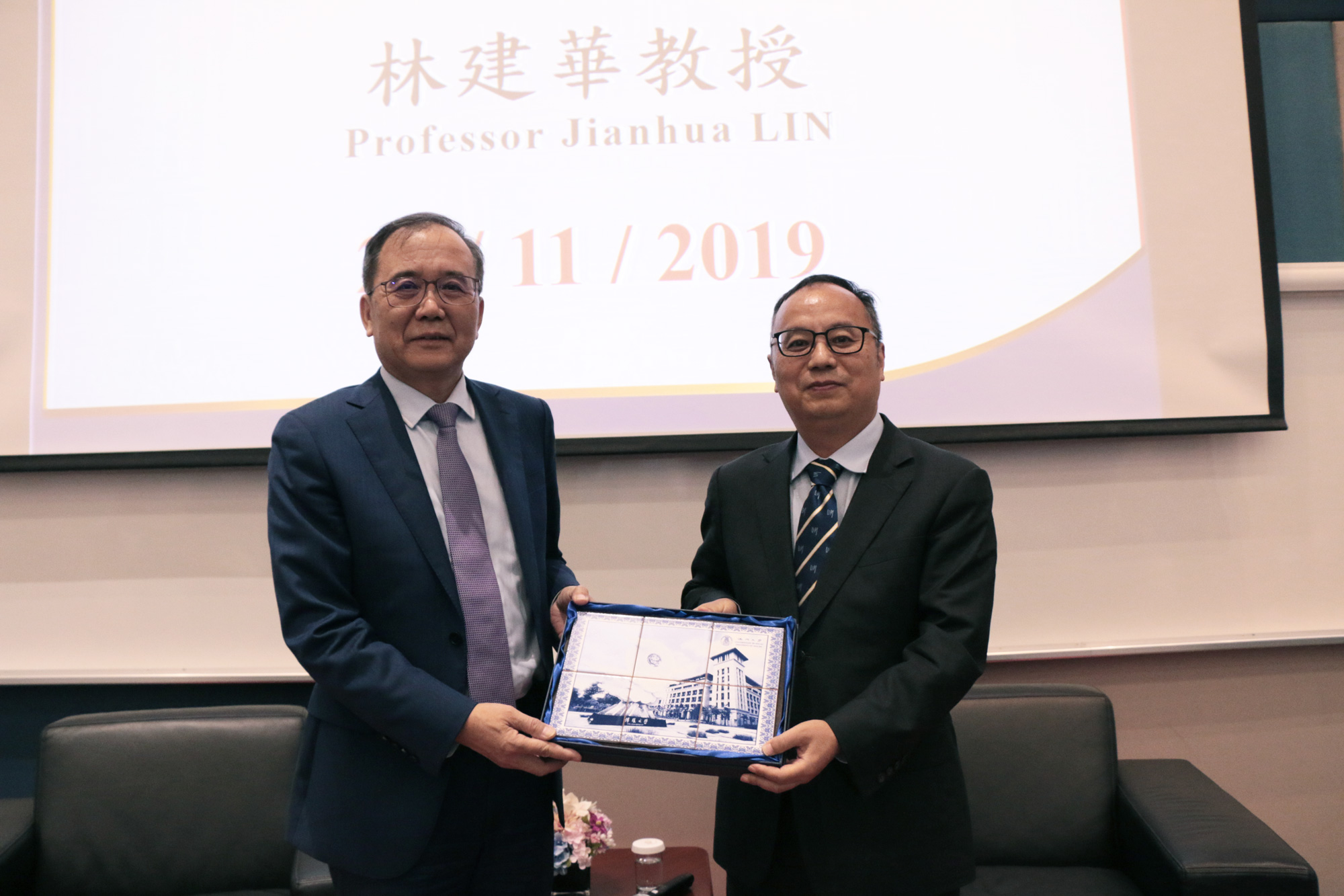 Yonghua Song (right) presents a souvenir to Lin